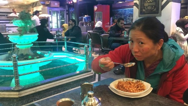 Jennifer tries koshari, Egypt's national dish, for the first time.